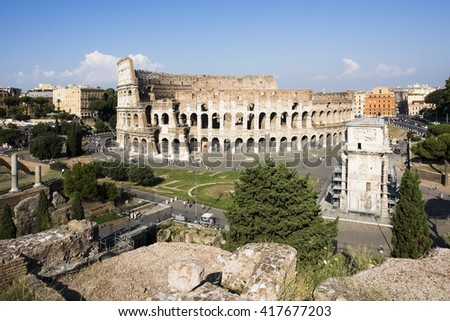 Colosseum and Arch of Titus - stock photo