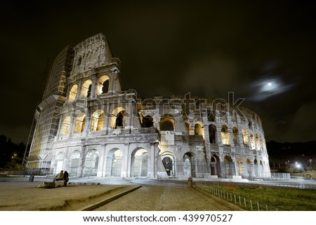 Colosseum (Coliseum) at night in Rome, Italy. The Coliseum is the main tourist attractions of Rome. It was built in the 1st century.  - stock photo