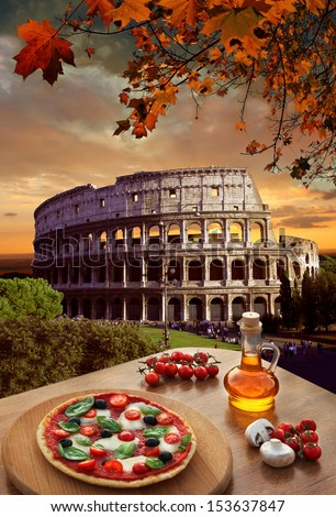 Colosseum in Rome with classic pizza in Italy - stock photo
