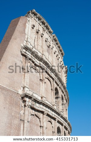 Colosseum monument in Rome, arch part with summer blue sky - stock photo