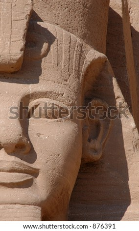 colossi of Ramses II in front of the Sun Temple of Abu Simbel near Aswan, Egypt - stock photo