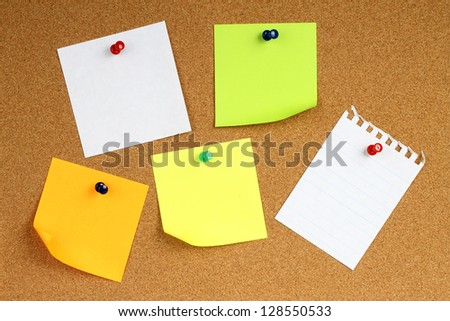 Colour note papers on wooden background - stock photo