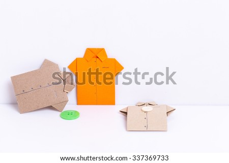 colour paper origami. Paper origami shirts and heart isolated on white background. - stock photo