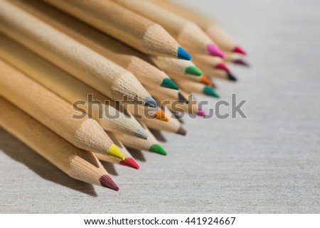 Colour pencils,  flat lay, colored pencils lay in a heap, school design, items for school design, colored flat education tools, copyspace, crayons   - stock photo