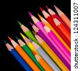 Colour pencils isolated on black background close up - stock photo