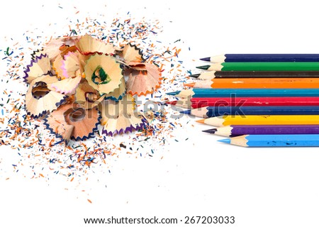 Colour pencils with sharpening shavings isolated on white - stock photo