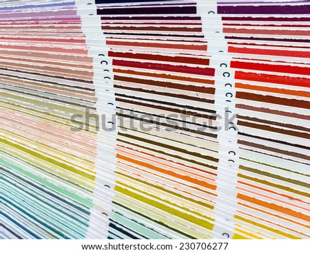 Colour swatches book with rainbow sample colors catalogue - stock photo