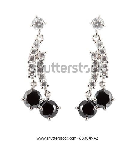 coloured earrings on white - stock photo