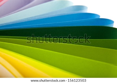 coloured paper on a white background. One picture from series. - stock photo