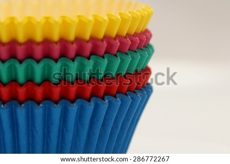 Coloured Paper Pans baking cups for cupcakes and muffins - stock photo