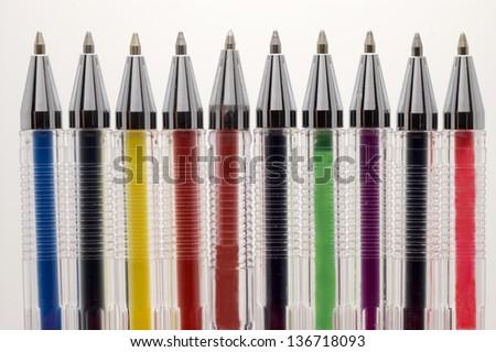 Coloured pens on white background. - stock photo