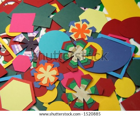 Coloured shapes cut with shape cutter from coloured card for scrapbooking or cardmaking crafts - stock photo