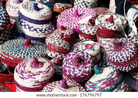 Colourful baskets with lid made of date palm leaves - stock photo