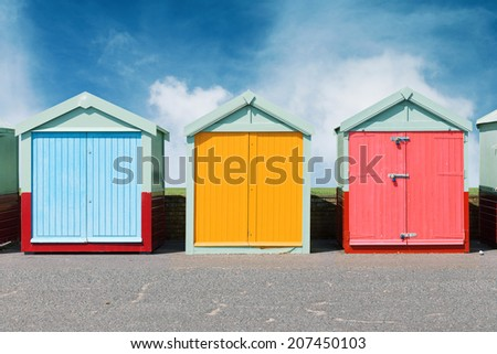 Colourful beach huts in Brighton on the beach - stock photo