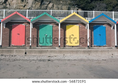 Colourful beach huts Multi-coloured doors to beach huts on the beach at Swanage, Dorset. - stock photo