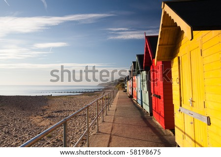 Colourful beach huts on the Cromer beach - stock photo