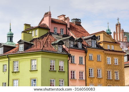Colourful buildings in Warsaw Old Town square in Poland - stock photo