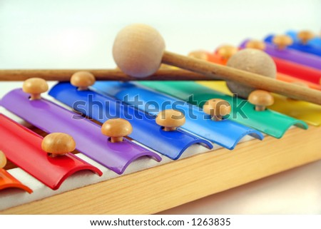 colourful child's glockenspiel with two crossed mallets - stock photo