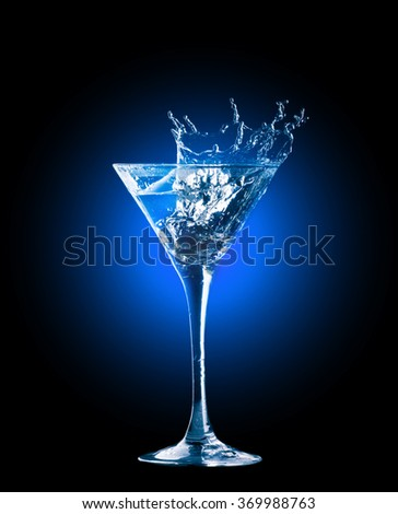 colourful cocktail with splashes on the black background - stock photo