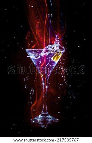 colourful coctail on the black background - stock photo