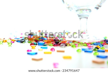 Colourful craft plastic beads with glass on white background - stock photo