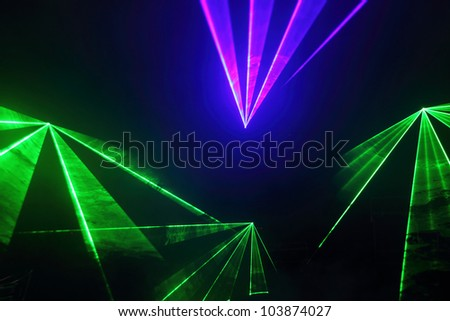 Colourful Disco with special effects and fantastic laser show - stock photo