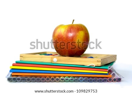 Colourful exercise books and other school supplies - stock photo