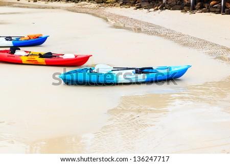 Colourful kayaks on tropical beach at KohKood, thailand. - stock photo