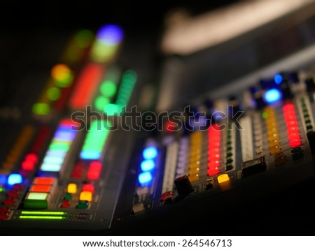Colourful mixer with buttons and hand - stock photo