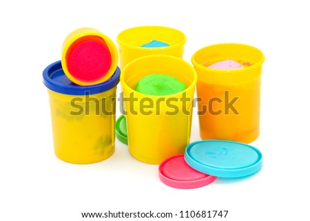 Colourful molding dough for children isolated on white background - stock photo