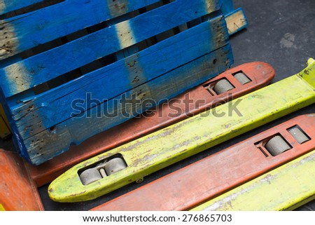Colourful pallet and pallet pumps in an abstract angle, logistic concept - stock photo