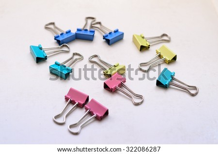 Colourful Paper Clips on an isolated background - stock photo