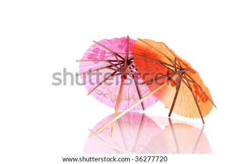 Colourful paper umbrellas forming a bright background. - stock photo