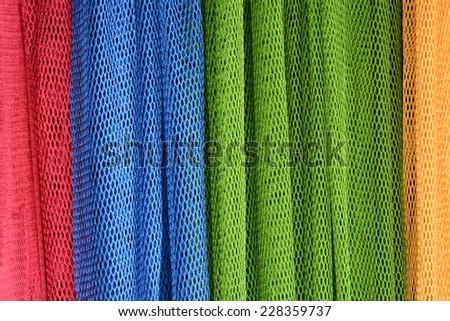 Colourful pieces of nylon hammock as background  - stock photo