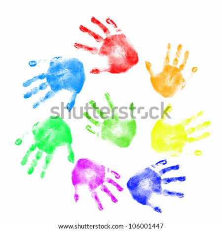 Colourful prints of human hands on white background - stock photo