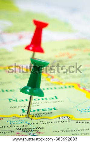 Colourful Pushpins on a Road Map of New Hampshire - stock photo