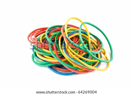 colourful rubber bands over white - stock photo