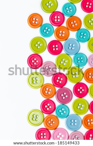 Colourful sewing buttons background with copy space - stock photo