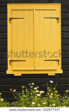 Colourful shuttered window - stock photo