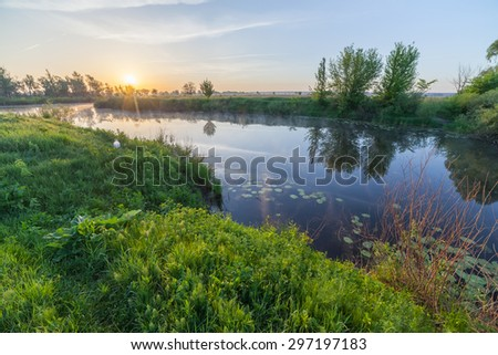 Colourful sunset on the river. The Ukraine - stock photo