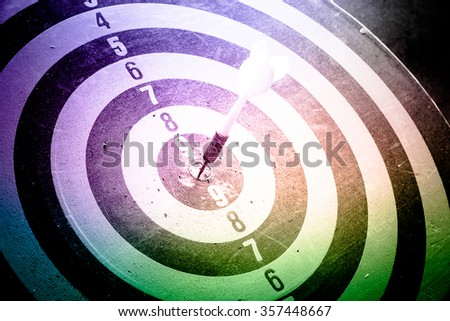 Colourful tone - Dart is an opportunity and Dartboard is the target and goal with vintage retro picture style. success/fail business concept. Bullseye and Dart. - stock photo