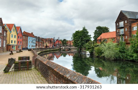 Colourful town houses at Quay Side overlooking the river Yare in Norwich, Norfolk - stock photo