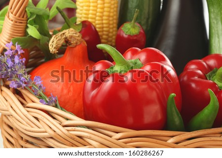 Colourful vegetables and flowers inside the basket - stock photo
