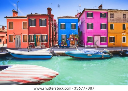 Colourfully painted house facade on Burano island, province of Venice, Italy - stock photo
