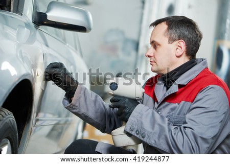 colourist man compare color sample with car paint  - stock photo