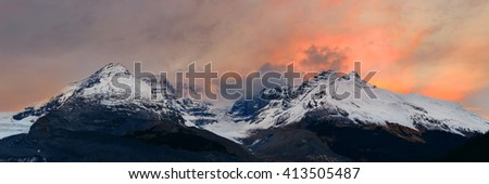 Columbia Icefield panorama with snow covered mountains at sunrise in Banff Jasper National Park, Canada.  - stock photo
