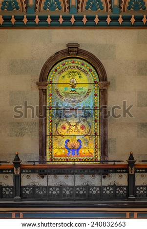 COLUMBIA, SOUTH CAROLINA - DECEMBER 9: Stained glass state seal in the main lobby of the South Carolina State House on December 9, 2014 in Columbia, South Carolina - stock photo