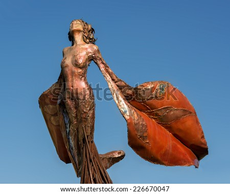 COLUMBUS, INDIANA - OCTOBER 22: Eos sculpture (Dessa Kirk) at Fifrth and Lindsey Streets on October 22, 2014 in Columbus, Indiana - stock photo