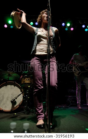 COLUMBUS, OH - JUNE 12: Company of Thieves vocalist Genevieve Schatz performs at the Newport Music Hall, Columbus on June 12, 2009. - stock photo