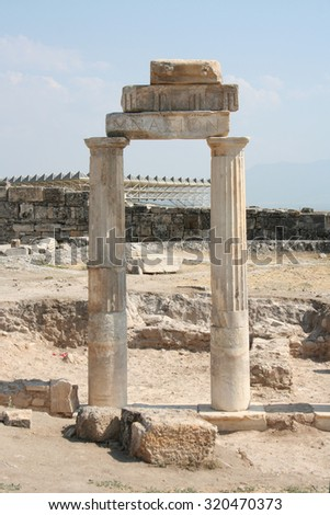 Column of gimnazion in the ruined ancient city Hierapolis - stock photo